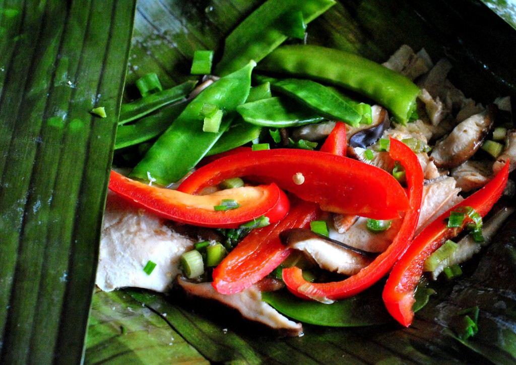 Rainbow trout baked in banana leaves